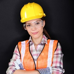 Construction worker with safety vest, glasses and hardhat portra